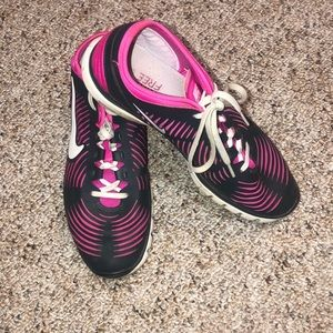 Nike Frees - women size 9, pink and gray.